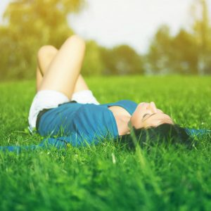 Woman Relaxing in a field