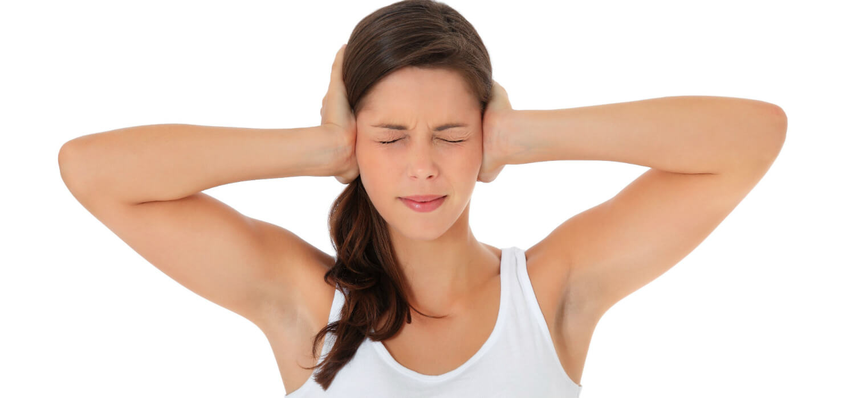 Woman suffering from tinnitus